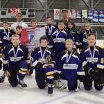 Finaliste Atome B: Accès-Pharma Matane, bannière commandite l'École de Hockey Sport performance